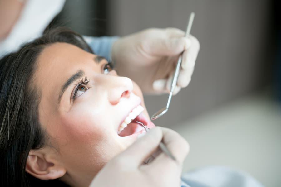 woman getting dental exam